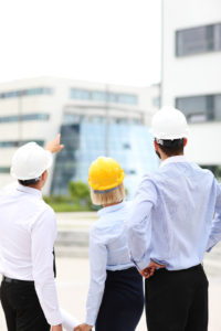 A picture of a group of architects on site pointing at modern buildings